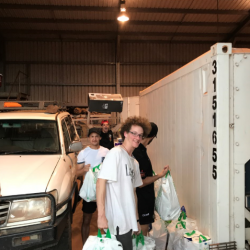 DAs helping to load food supplies at Yirrkala